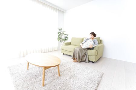single woman being relaxed at home Imagens
