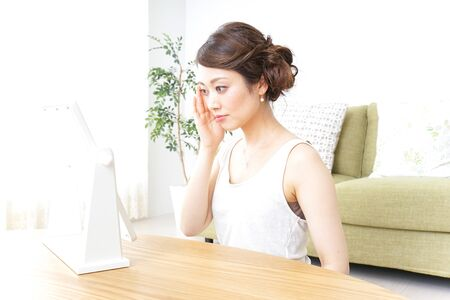 woman making herself up at home Stock Photo