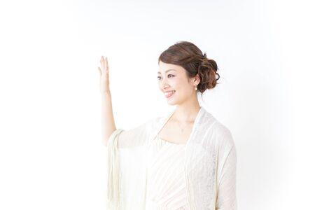 woman in dress waving her hands