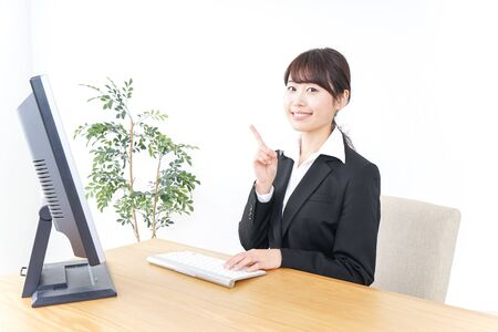 business woman pointing to something in office Stok Fotoğraf