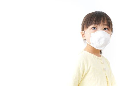 A child wearing a face mask Stock Photo
