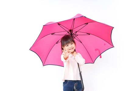 A child opening an umbrella