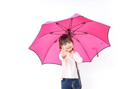 A child opening an umbrella
