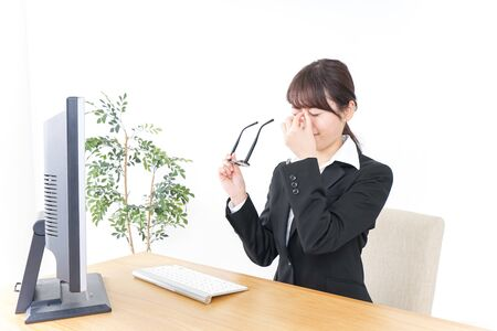 business woman suffering from dry eye
