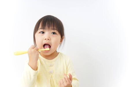 A child brushing her teeth Stock Photo