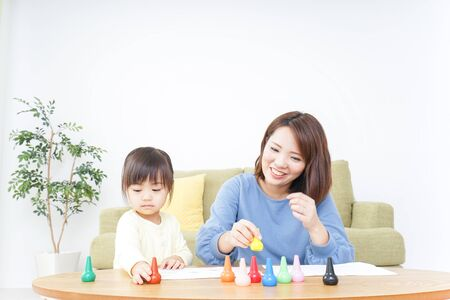 A parent and child painting a picture