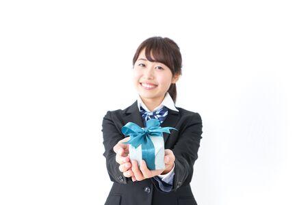 high-school girl giving present