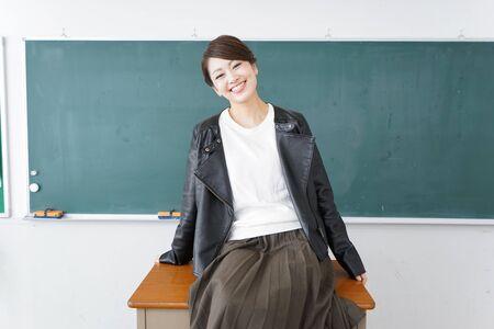Bad student sitting on a teacher's desk