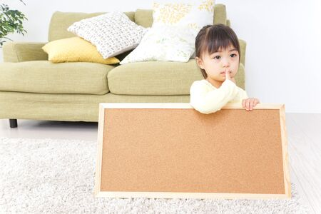Crying child having a board