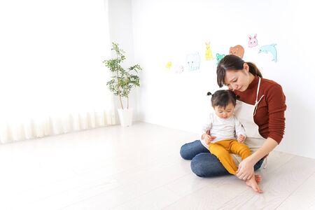 Nursery teacher care child having a cold