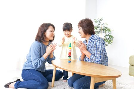 Happy family playing with child