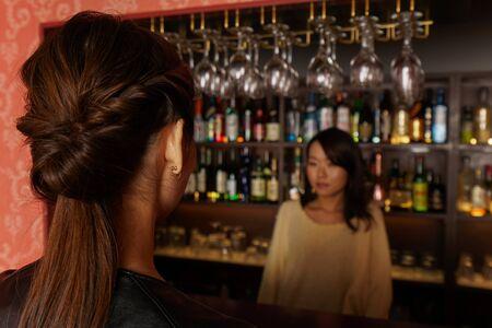 women in bar counter