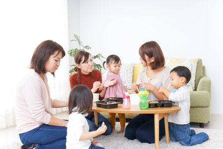 Mothers' friends and children doing party