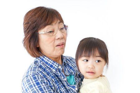 Grandmother hugging grandchild