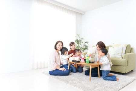 Mothers' friends and children doing party Stock Photo