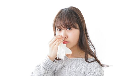 Woman getting a bloody nose Stock Photo
