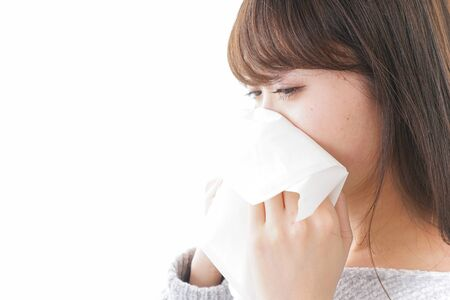 Woman blowing her nose Archivio Fotografico