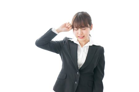 Businesswoman suffering from headache