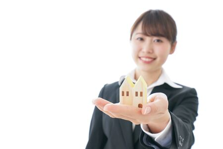 Businesswoman doing real estate business Stock Photo
