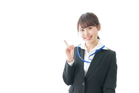 Young woman pointing to point