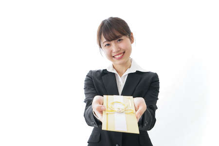Woman in suit giving congratulatory gifts of money