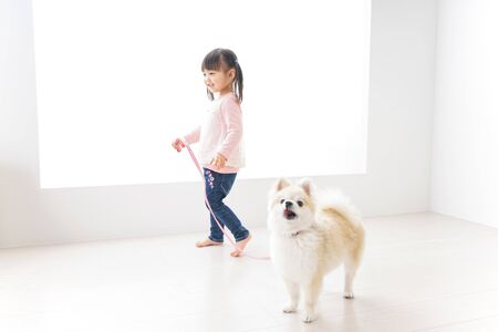 Child taking a walk with dog