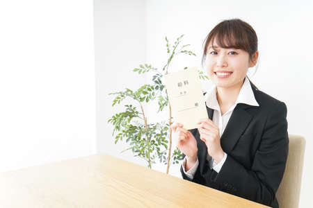 Businesswoman being delighted at salary