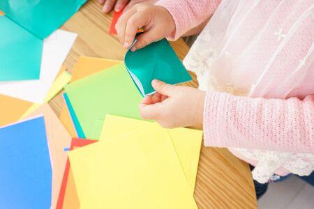 Child folding origami paper