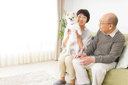 Aged couple having a dog