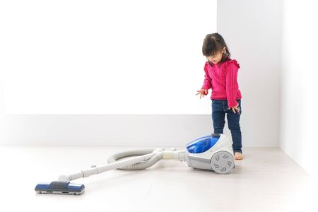 Child vacuuming the floor Stock fotó