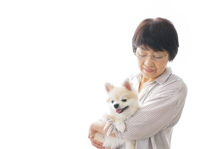 Aged woman buying a dog