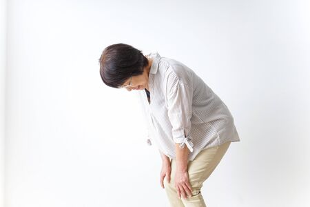Aged woman suffering from pain in knee Stock fotó