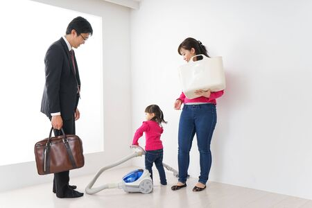 Father going to work, mom and daughter