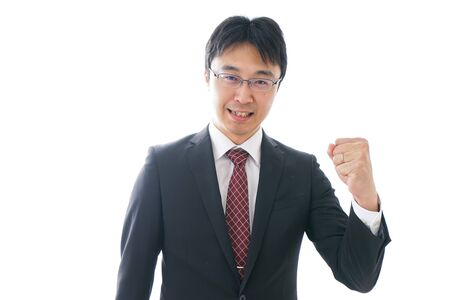Businessman holding up fists Stock fotó