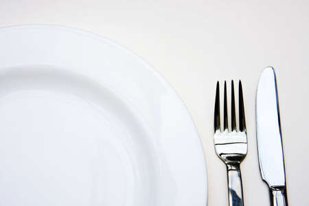 Part of plate,fork and knife photo