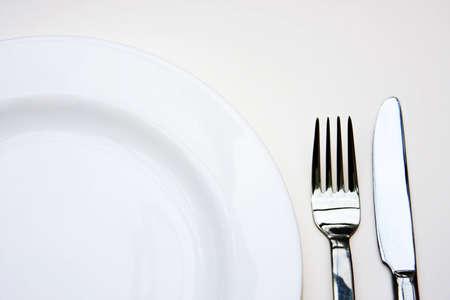 Parte della piastra, forchetta e coltello