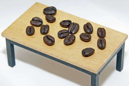 coffeebeans: Coffee-beans on a table Stock Photo