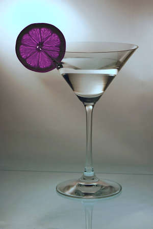 Cocktail glass with a pink lemon slice  Stock Photo