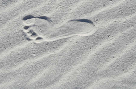 lonliness: Footprint in the sand