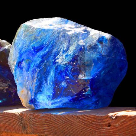 A close up of a shiny blue stone