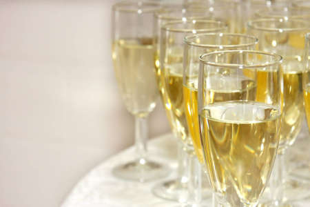 Closeup of glasses filled with sparkling wine and copy space Stock Photo