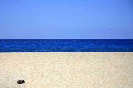 Sandy beach with blue sea and sky in horizontal format Stock Photo - 11011749