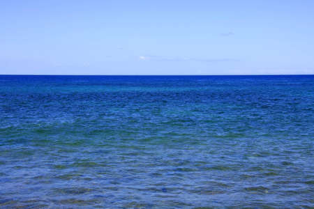 Blue sea with almost no clouds in the sky Stock Photo - 11011754