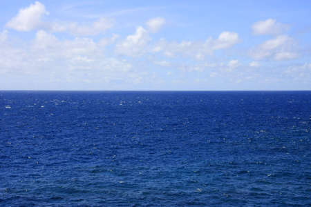 Deep blue sea with cloudy sky Stock Photo - 11011752