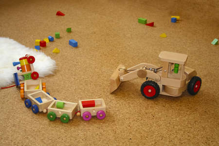 Wooden toys lying on the floor photo