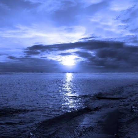Sunset at the ocean blue filtered light