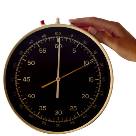 Isolated huge timer with hand starting the timing photo