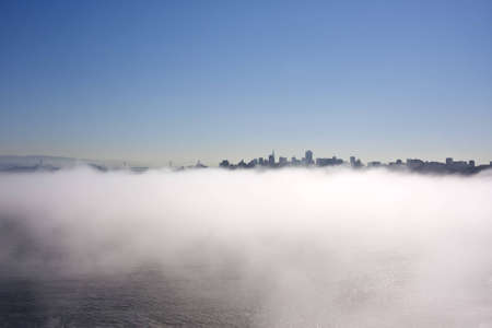 San Francisco skyline from Golden Gate Bridge with fog in the morning photo