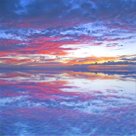 Evening sky with reflection in the water photo