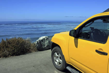 itinerary: A car is parking right at the coast